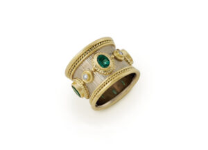 Yellow and white gold templar ring with emeralds and diamonds; fine jewellery London