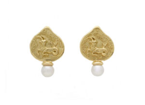 Gold earrings with Capricorn motif and Akoya pearls; fine jewellery London