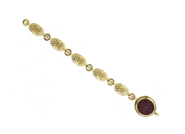 Carved-gold-bracelet-with-red-glass-intaglio-BMS26451-600×434