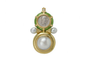 Gold pin with silver coin and lime green enamel, pearls and diamond; fine jewellery London
