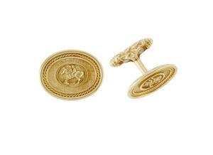 Gold zodiac cufflinks with gemini motif; fine jewellery London