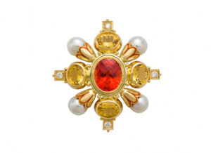 Gold kiss pin with dark mandarin garnet, and yellow beryls; gold brooch; fine jewellery London