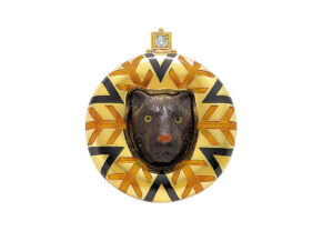 Gold pin with panther head carved in petrified palm tree, orange and black enamel, diamond and gold beads; fine jewellery London; gold brooch