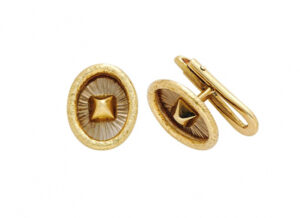 Yellow and white gold dress studs with planished gold pyramid; fine jewellery London