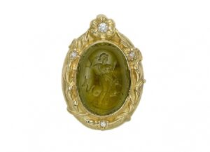 Gold pendant with yellow tourmaline intaglio of Aphrodite, diamonds and carved flowers; fine jewellery London