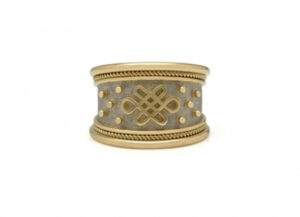 Yellow and white gold tapered templar ring with eternal knot motif; fine jewellery London