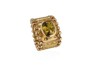 Gold tapered Agincourt ring with yellow mali garnet and diamonds; fine jewellery London