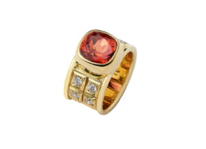 Pink-orange-tourmaline-ring-with-diamonds-and-carved-plinths-MIS26497