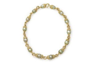 Gold necklace with pistachio green pearls; fine jewellery London