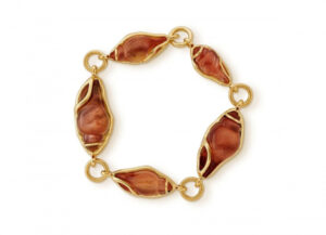 Gold bracelet with sunstone shell cameo and molten gold surrounds; fine jewellery London