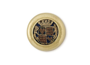 Gold pin with engraved heraldic copper roundel; fine jewellery London