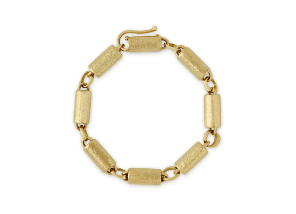 Gold bracelet comprising 8 yellow planished gold tubes and molten gold jump rings; fine jewellery London