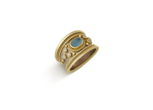 Yellow and white gold Templar ring set with aquamarine; fine jewellery London