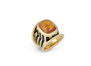 gold ring featuring cushion-shaped sugarloaf cabochon mandarin garnet; fine jewellery London