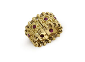 Gold flexible Agincourt band ring with rubies; fine jewellery London