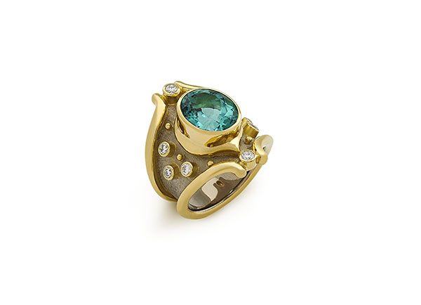 Yellow & white gold Heliotrope ring featuring a blue-green tourmaline with diamonds; fine jewellery London; Elizabeth Gage