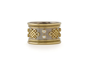 Yellow and white gold Eternal Knot ring with diamonds; fine jewellery London